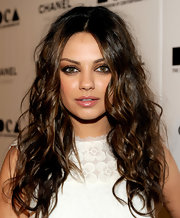 For her beauty look, Mila Kunis paired a glossy pink lip with a smoky eye.