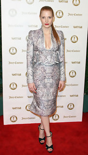 Jessica Chastain looked very polished at the Vanities party in a silver ruffle skirt suit by Alexander McQueen.