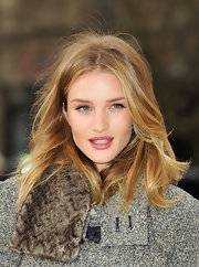Rosie Huntington-Whiteley arrived for the Burberry fashion show rocking a windblown center-parted 'do.
