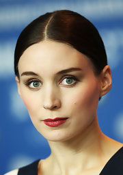 Rooney Mara polished off her look with a swipe of red lipstick.