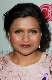 Mindy Kaling got glam with this side chignon for the 2011 Pink Party.