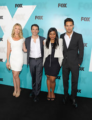 Mindy Kaling layered a draped white leather jacket over a beaded black dress for the Fox 2012 Progamming Presentation.