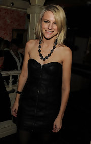 Laura Brown adorned her bare neckline with a chunky black statement necklace.