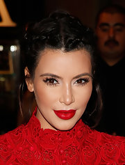 Kim Kardashian styled her hair with side braids pulled back into a charming updo for a meet-and-greet in Vegas.
