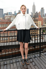 Leelee Sobieski paired a modern dolman-sleeve leather jacket with a flirty mini skirt for the Women's Filmmaker Brunch.
