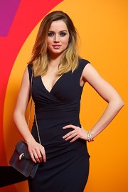 Ana de Armas accessorized with a chic chain-strap bag by Bulgari at the premiere of 'Los Amantes Pasajeros.'
