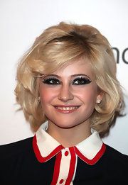 Pixie Lott went for a bold beauty look with heavily rimmed eyes.