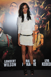 Liya Kebede contrasted her demure top with a flirty white mini skirt.
