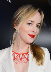 Dakota Johnson accessorized with a tribal-chic beaded statement necklace during the Tommy Hilfiger LA flagship opening.