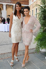 Eva Longoria chose a pair of nude ankle-strap platform pumps by Brian Atwood to complement her dress.