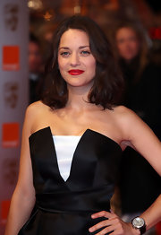Marion Cotillard attended the Orange British Academy Film Awards sporting a diamond-encrusted chronograph watch by Chopard.
