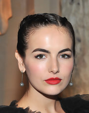 Camilla Belle sat front row at the Marchesa fashion show wearing her hair in double French braids.
