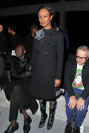 Shala Monroque exuded retro charm in this charcoal wool coat during the Kanye West fashion show.