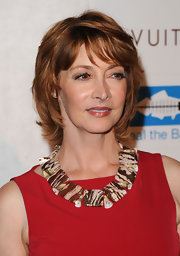 Sharon Lawrence attended the opening of Louis Vuitton Santa Monica wearing her hair in a layered razor cut.