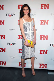 For a vibrant pop to her monochrome outfit, Hilary Rhoda accessorized with a tricolor Rebecca Minkoff Coco clutch.