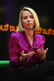 Marissa Mayer attended the DLD conference looking classic in a fuchsia silk tie-neck blouse.