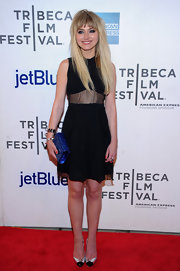 Imogen Poots added a pop of color with a metallic blue clutch by Jimmy Choo.