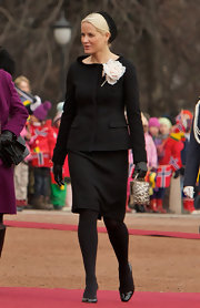 Princess Mette-Marit styled her look with a printed purse.