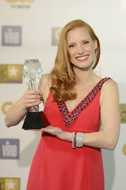 Jessica Chastain showed off her trophy and some stunning diamond and gemstone bling by Harry Winston during the Critics' Choice Movie Awards.