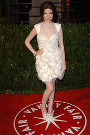 Anna Kendrick paired her dress with white satin platform peep-toes.