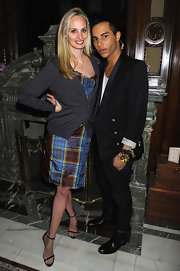 Lauren Santo Domingo layered a gray cardigan over a colorful plaid dress for the Midnight Supper event.