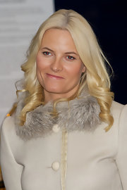 Princess Mette-Marit wore her hair in spiral curls at the opening of the Jubilee Exhibition 'Royal Journeys 1905 - 2005.'