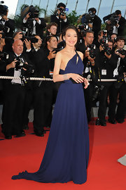 Shu Qi donned a midnight blue one-shoulder gown with a floor-sweeping train at the 'Coco Chanel & Igor Stravinsky' premiere at the 62nd Cannes Film Festival.