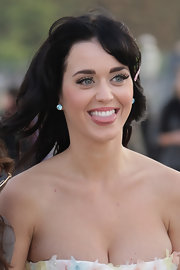 Katy Perry accessorized with sparkling gemstone studs at the Dior Spring 2008 show.
