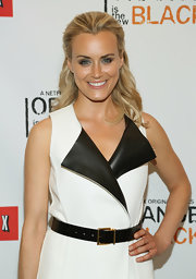 Taylor Schilling paired a black leather belt with a sleeveless coat dress for the New York premiere of 'Orange is the New Black.'