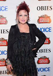 Cyndi Lauper topped her ruffle dress with a black zip-up jacket at the 2013 Obie Awards.