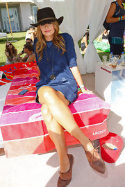 Stana Katic was casual and cool in a denim mini dress during the Fiji Water desert pool party.