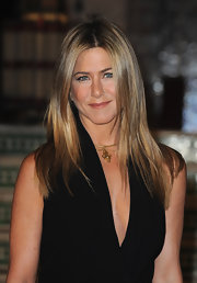 Jennifer Aniston styled her black dress with a lovely gold pendant necklace.