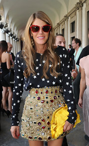 Anna dello Russo attended the Missoni fashion show wearing fun and chic red-framed wayfarers.
