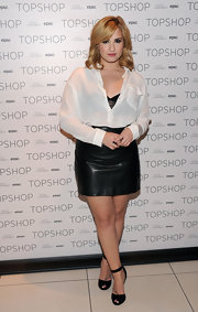 For her footwear, Demi Lovato chose a pair of black ankle-strap peep-toes, also by Topshop.