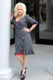 Cyndi Lauper was spotted shopping at Peacock Boutique wearing a gray wrap dress.