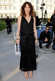Vanessa Paradis went for an art deco look with a faux-wrap beaded dress at the Chanel Resort Show. The drop-waist design stopped at her ankles to reveal nude platform sandals and a red pedicure. Vanessa accessorized with gold to complete this vintage inspired look.