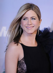 Jennifer Aniston finished off her look with dangling spike earrings.