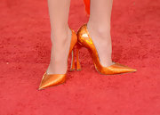 Marion Cotillard set the red carpet alight in flame orange sequined stilettos at the 70th Annual Golden Globe Awards.
