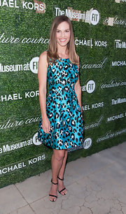 Hilary Swank added a dose of sexiness to her look with a pair of barely-there sandals.