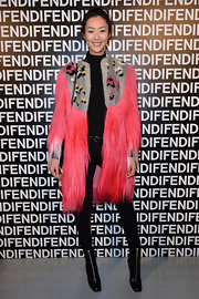Liu Wen was a flamboyant head turner in her neon-pink Fendi fur coat during the label's fashion show.