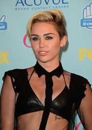 Miley Cyrus teamed a black leather bra with a see-through top, both by Saint Laurent, for the 2013 Teen Choice Awards.