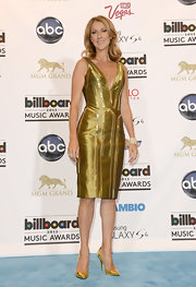 Celine Dion matched her frock with a pair of gold pumps.
