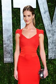 Rosie Huntington-Whiteley's silver Jimmy Choo Calista clutch paired elegantly with her red gown at the Vanity Fair Oscar party.