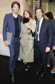 Carine Roitfeld chose a nude nylon trenchcoat for the Fendi fashion show.