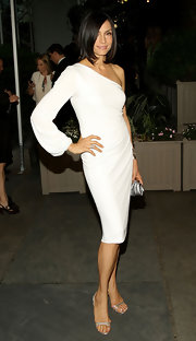 Famke Janssen partnered her white dress with a pair of silver Jimmy Choos.