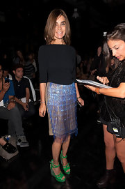 Carine Roitfeld did some color blocking, pairing her blue skirt with retro-chic green wedges.
