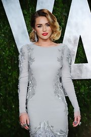 Miley Cyrus hit the 2012 Vanity Fair Oscar party wearing some gorgeous Lorraine Schwartz rocks.