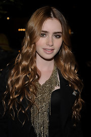 Lily Collins attended the Chanel pre-Oscar dinner wearing a mega-chunky gold chain necklace.