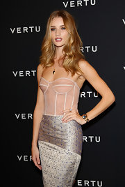 Rosie Huntington-Whitely was sexy-glam at the Vertu global launch of the Constellation with this gemstone bracelet and corset dress combo.
