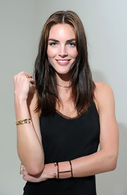 Hilary Rhoda attended the Jennifer Fisher presentation wearing an elegant gold cuff from the label.